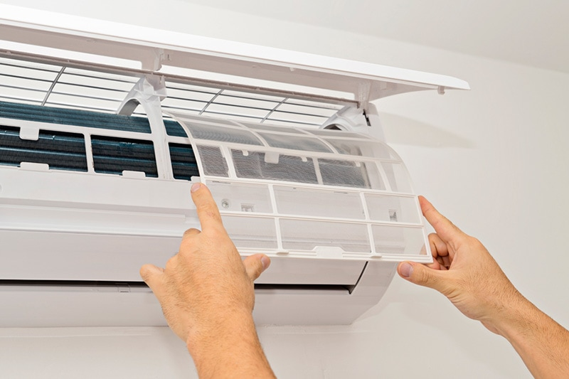 techician fixing a ductless system