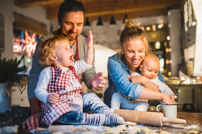 happy family baking in the kitchen, 6 Ways Your Furnace Keeps You Safe | Comfortable Design | Lancaster PA