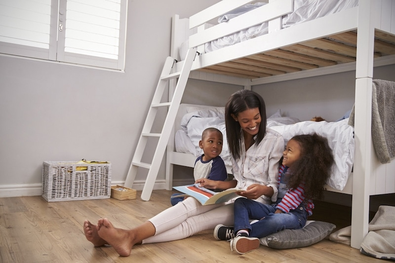 Mother Reading Story To Children In Their Bedroom, Why Is Indoor Air Quality (IAQ) Important? | Comfortable Design | York, PA