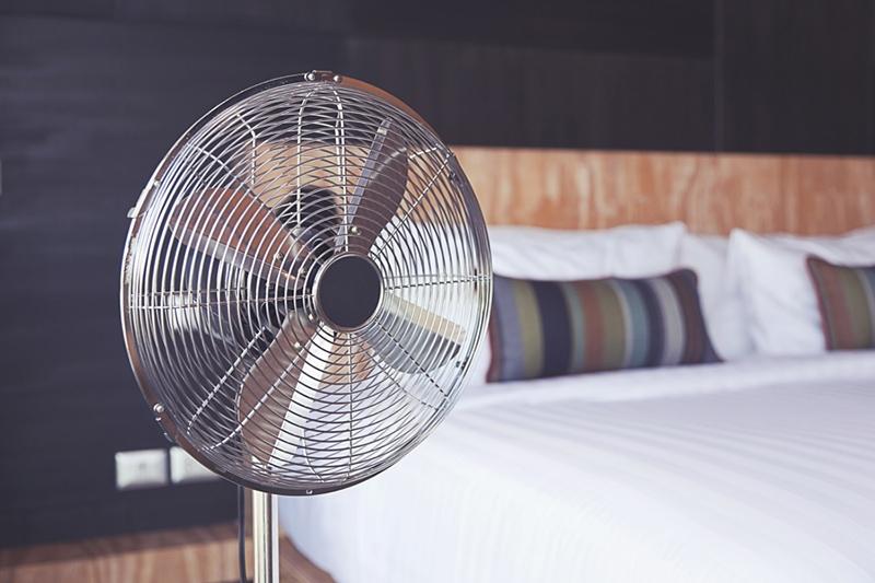 metal fan in bedroom